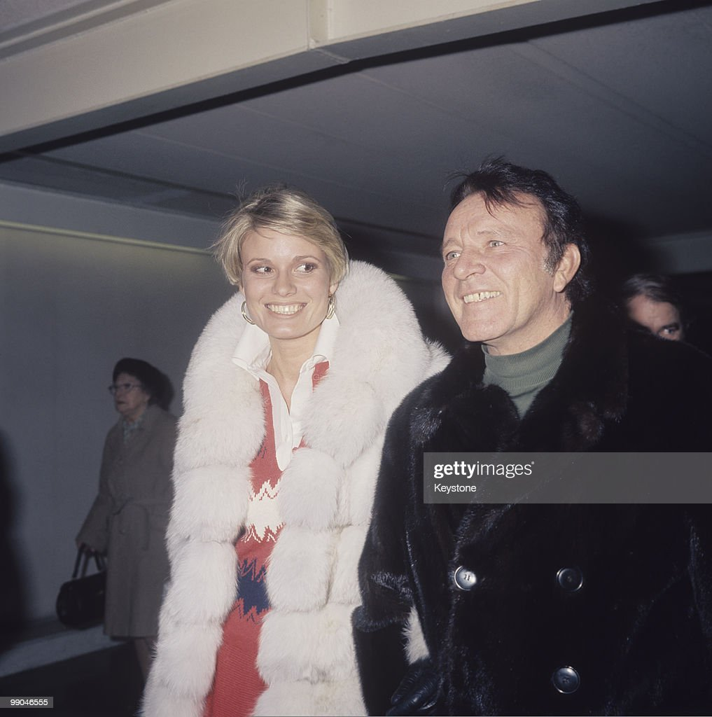 Richard Burton (1925-1984), actor, and his fourth wife, Susan Hunt, pictured at Heathrow Airport, London, Great Britain, circa 1977.