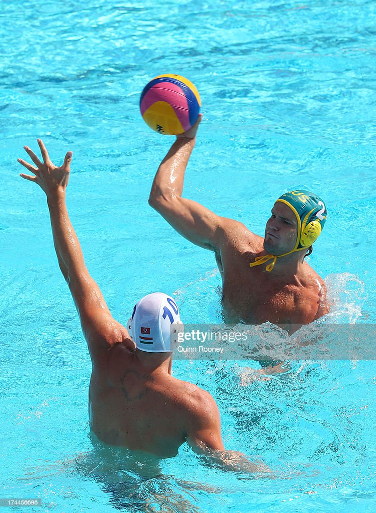Richard Campbell of Australia in action against Denes Varga of Hungary during the Men's Water Polo first preliminary round match between Hungary and...