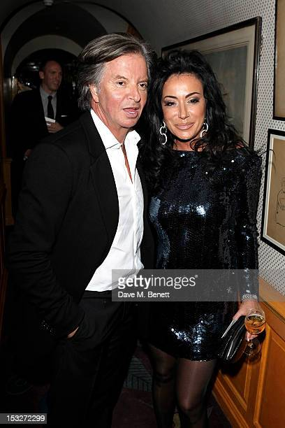 Richard Caring and Nancy Dell'Olio attend Ben Caring's birthday party at Annabel's on October 2 2012 in London England