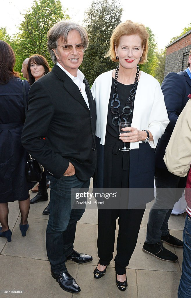 Richard Caring (L) and Serpentine Gallery Co-Director Julia Peyton-Jones attend the launch of 'Serpentine', a new fragrance by The Serpentine Gallery and fashion house Comme des Garcons featuring packaging artwork by Tracey Emin, at The Serpentine Gallery on April 28, 2014 in London, England.
