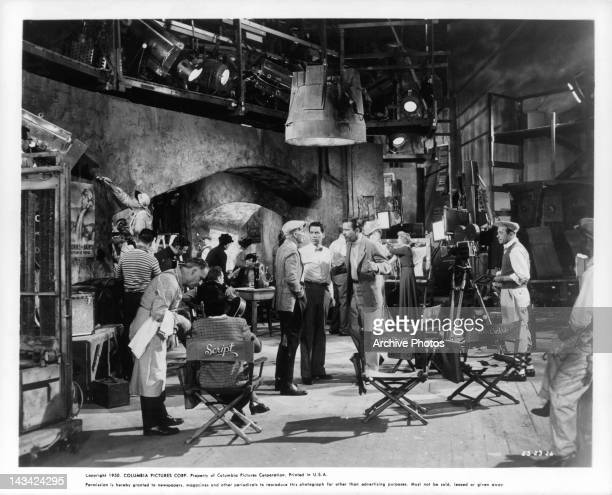 Richard Carlson on film set with crew in a scene from the film 'Valentino' 1951