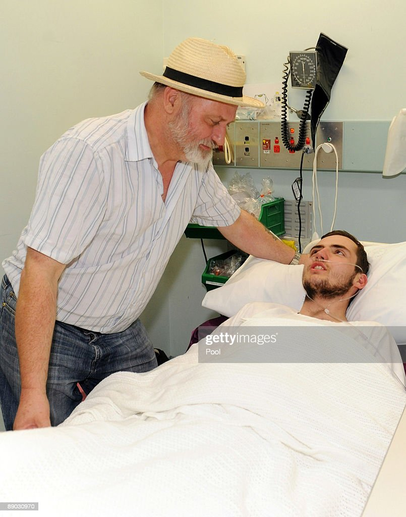 Richard Cass (L) with his son Jamie Neale at the Blue Mountains District ANZAC Memorial Hospital July 15, 2009 in Katoomba, Australia. Jamie Neale, an English backpacker, was found earlier today after surviving 12 days lost in the bush near Katoomba suffering from only dehydration and exposure.