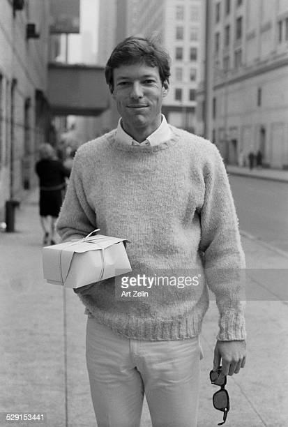 Richard Chamberlain on the street carrying a pastry box circa 1970 New York