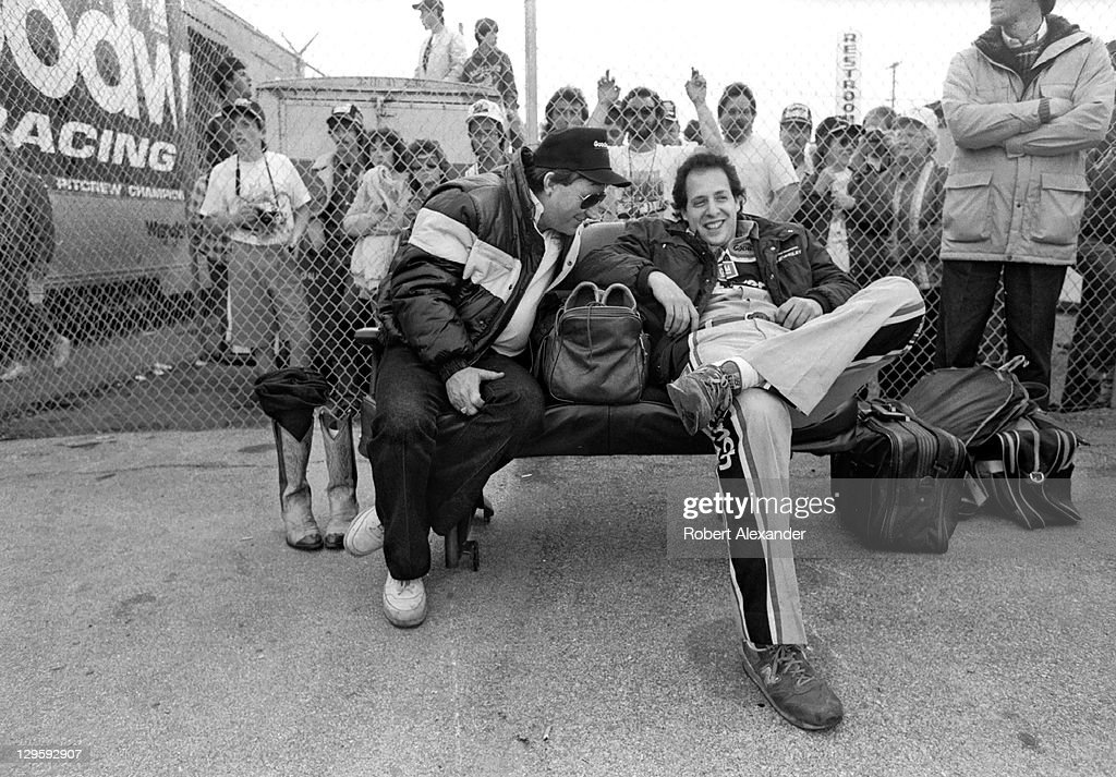 Richard Childress left owner of the Goodwrench NASCAR race car driven by Dale Earnhardt Sr relaxes with his team's crew chief Kirk Shelmerdine in the...