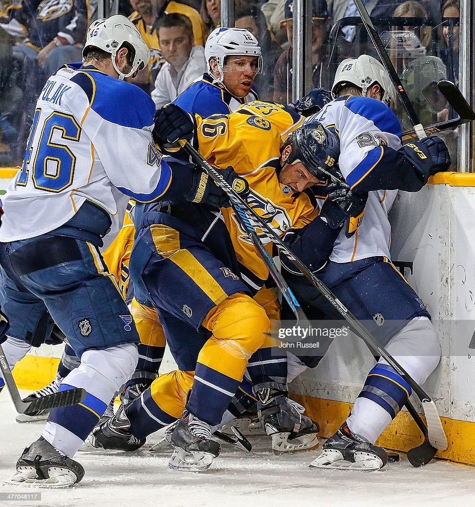 <a gi-track='captionPersonalityLinkClicked' href=/galleries/search?phrase=Richard+Clune&family=editorial&specificpeople=2122646 ng-click='$event.stopPropagation()'>Richard Clune</a> #16 of the Nashville Predators battles for the puck along the boards against <a gi-track='captionPersonalityLinkClicked' href=/galleries/search?phrase=Kevin+Shattenkirk&family=editorial&specificpeople=4324986 ng-click='$event.stopPropagation()'>Kevin Shattenkirk</a> #22 and <a gi-track='captionPersonalityLinkClicked' href=/galleries/search?phrase=Roman+Polak&family=editorial&specificpeople=2109482 ng-click='$event.stopPropagation()'>Roman Polak</a> #46 of the St. Louis Blues at Bridgestone Arena on March 6, 2014 in Nashville, Tennessee.