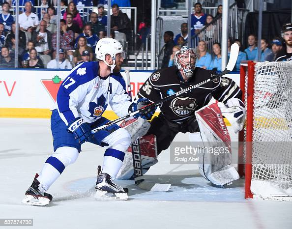 Richard Clune of the Toronto Marlies gets in the way of Justin Peters of the Hershey Bears during AHL Eastern Conference Final playoff game action on...