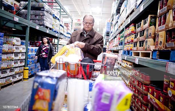 Richard Cobb shops inside a BJ's Wholesale Club store in Falls Church Virginia US on Thursday Dec 30 2010 BJ's Wholesale Club Inc rose 71 percent in...