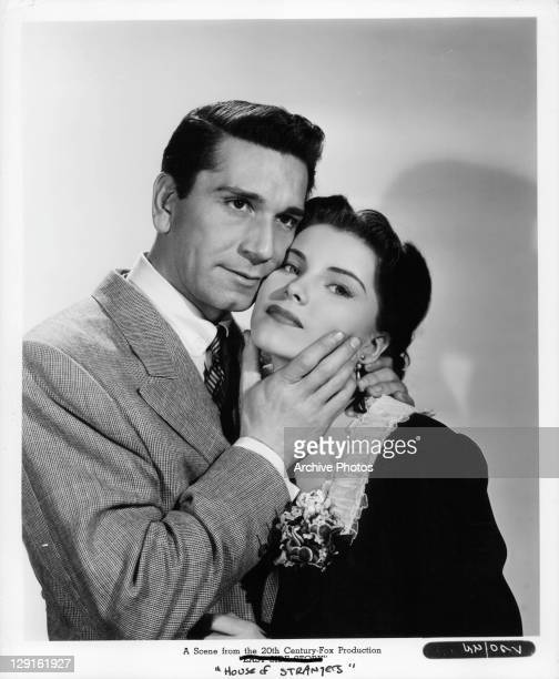 Richard Conte embraces Debra Paget in a scene from the film 'House Of Strangers' 1949