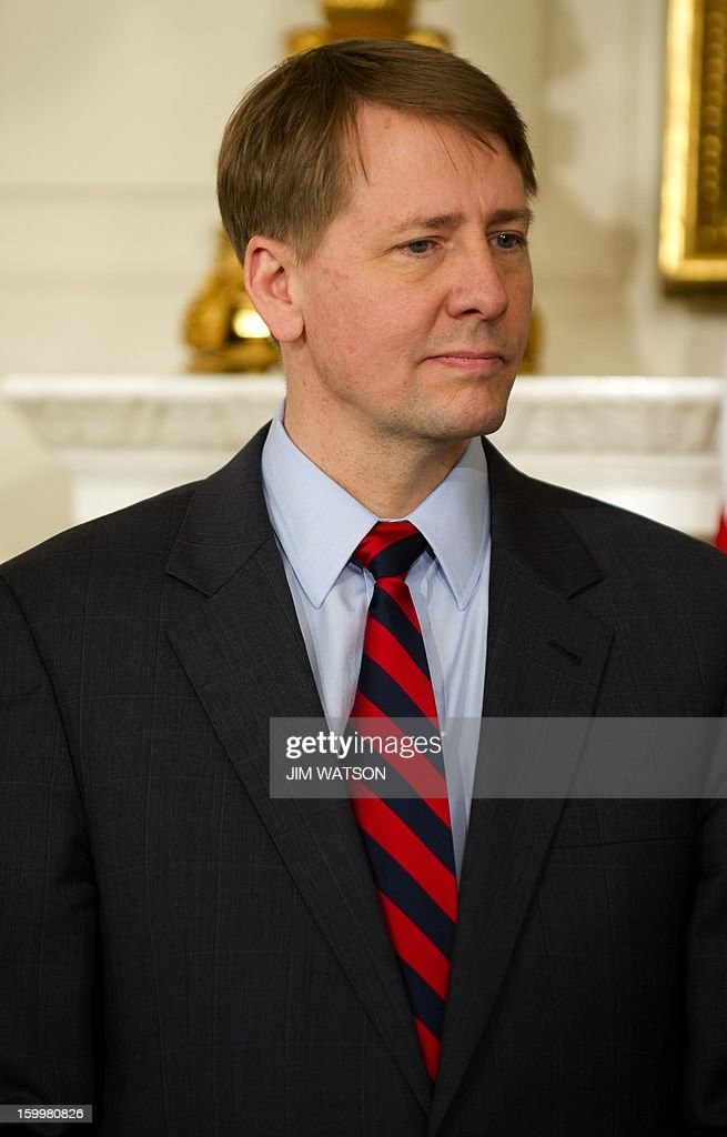 Richard Cordray after being renominated to serve as head of the Consumer Financial Protection Bureau during an event at the White House in Washington, DC, January 24, 2013. AFP PHOTO/Jim WATSON