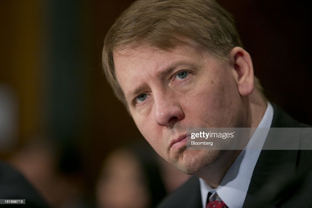 Richard Cordray, director of the Consumer Financial Protection Bureau (CFPB), listens during a Senate Banking Committee hearing in Washington, D.C., U.S., on Thursday, Feb. 14, 2013. U.S. regulators told lawmakers they are making significant progress to prevent a repeat of the 2008 credit crisis, pushing back against complaints of slow progress and efforts to undo parts of the Dodd-Frank Act. Photographer: Andrew Harrer/Bloomberg via Getty Images