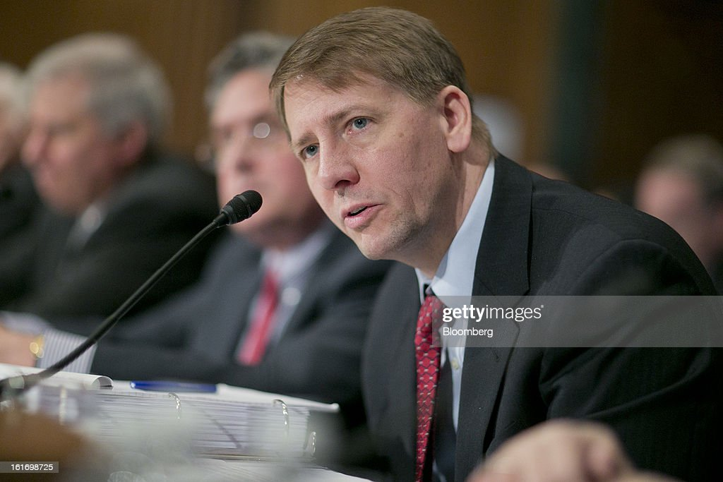 Richard Cordray, director of the Consumer Financial Protection Bureau (CFPB), speaks during a Senate Banking Committee hearing in Washington, D.C., U.S., on Thursday, Feb. 14, 2013. U.S. regulators told lawmakers they are making significant progress to prevent a repeat of the 2008 credit crisis, pushing back against complaints of slow progress and efforts to undo parts of the Dodd-Frank Act. Photographer: Andrew Harrer/Bloomberg via Getty Images