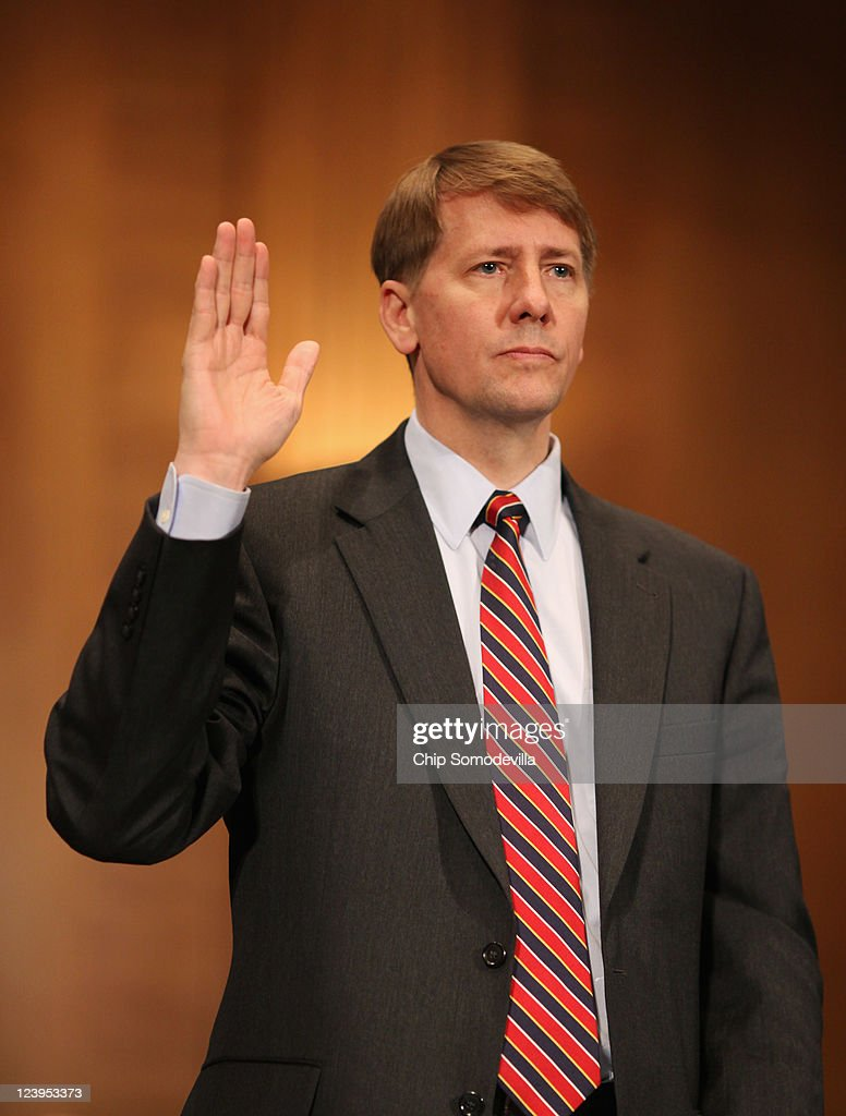 Richard Cordray is sworn in at the beginning of his confirmation hearing before the Senate Banking, Housing and Urban Affairs Committee on Capitol Hill September 6, 2011 in Washington, DC. Former Ohio Attorney General Cordray has been nominated by President Barack Obama to be the first director of the United States Consumer Financial Protection Bureau.