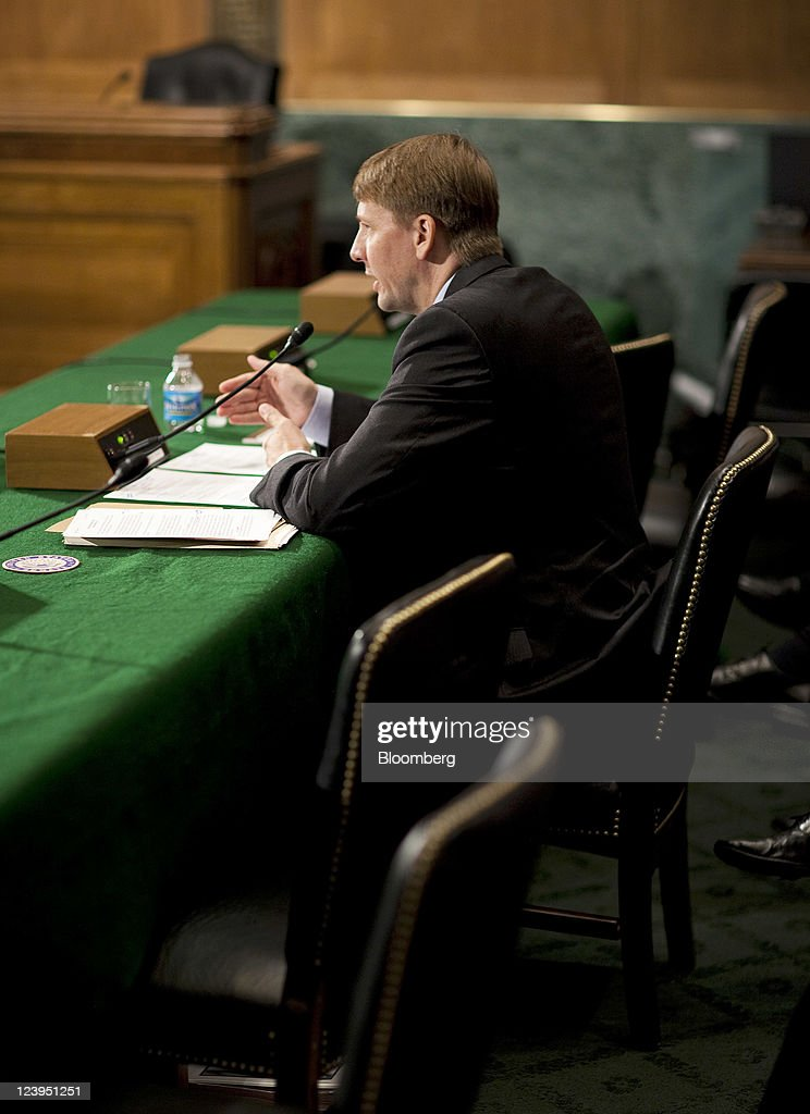 <a gi-track='captionPersonalityLinkClicked' href=/galleries/search?phrase=Richard+Cordray&family=editorial&specificpeople=7979683 ng-click='$event.stopPropagation()'>Richard Cordray</a>, President Barack Obama's choice to run the U.S. Consumer Financial Protection Bureau, testifies at his nomination hearing before the Senate Banking Committee in Washington, D.C., U.S., on Tuesday, Sept. 6, 2011. Cordray said he sees the new federal agency as a way to enhance consumer protections through a range of responses besides litigation. Photographer: Joshua Roberts/Bloomberg via Getty Images