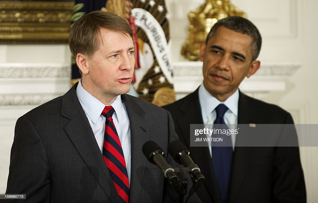 Richard Cordray speaks after US President <a gi-track='captionPersonalityLinkClicked' href=/galleries/search?phrase=Barack+Obama&family=editorial&specificpeople=203260 ng-click='$event.stopPropagation()'>Barack Obama</a> (R) renominated him to serve as head of the Consumer Financial Protection Bureau during an event at the White House in Washington, DC, January 24, 2013. AFP PHOTO/Jim WATSON
