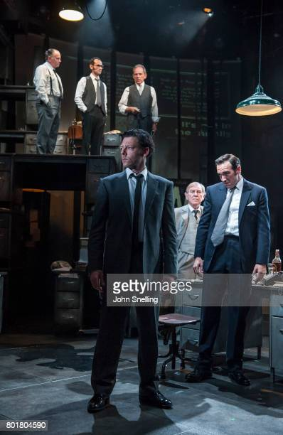 Richard Coyle as Larry Lamb and Bertie Carvel as Rupert Murdoch with the Company perform on stage in a new production of the play 'Ink' at The...