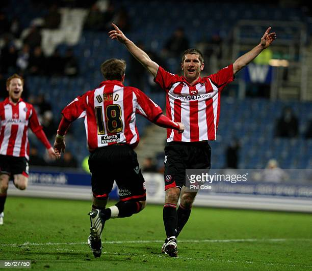 Richard Cresswell of Sheffield United celabartes scoring with Jamie Ward during the FA Cup third round replay match between Queens Park Rangers and...