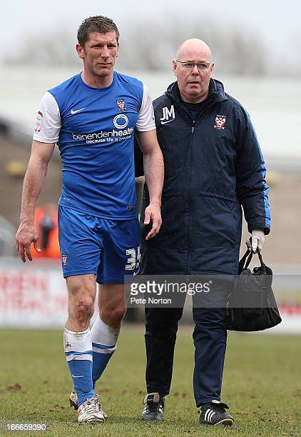 Richard Cresswell of York City is helped from the pitch by physio Jeff Miller during the npower League Two match between Northampton Town and York...