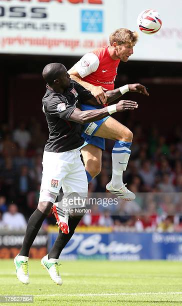 Richard Cresswell of York City rises above Kevin Amankwaah of Northampton Town to head the ball during the Sky Bet League Two match between York City...