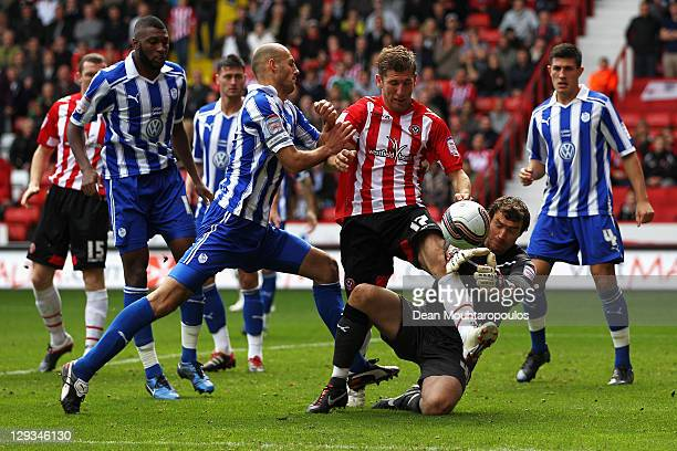 Richard Creswell of Sheffield United battles for the ball with Stephen Bywater and Rob Jones of Sheffield Wednesday during the npower League One...