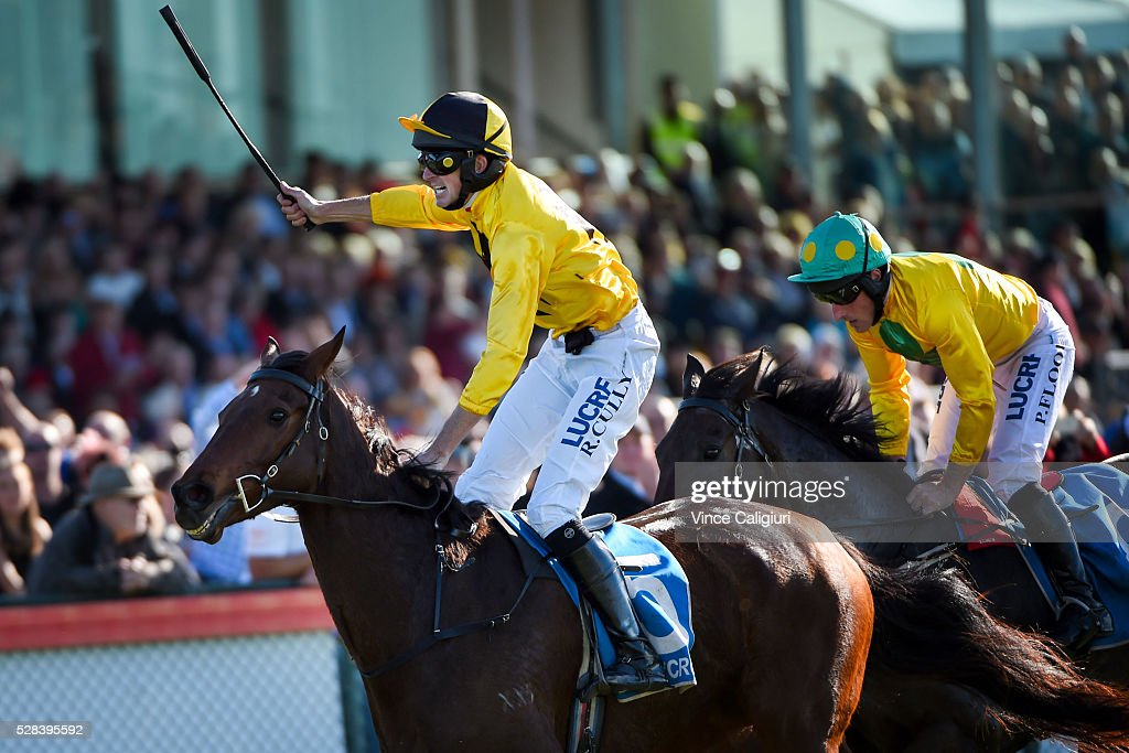 Richard Cully riding No Song No Supper celebrates on the line to win Race 7, Grand Annual Steeplechase during Grand Annual Day at Warrnambool Race Club on May 5, 2016 in Warrnambool, Australia.