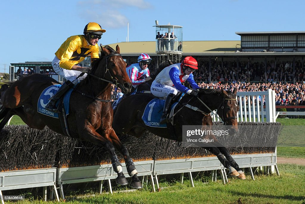 Richard Cully riding No Song No Supper (5) jumps beside Martin Kelly riding Thubiaan before winning Race 7, Grand Annual Steeplechase during Grand Annual Day at Warrnambool Race Club on May 5, 2016 in Warrnambool, Australia.