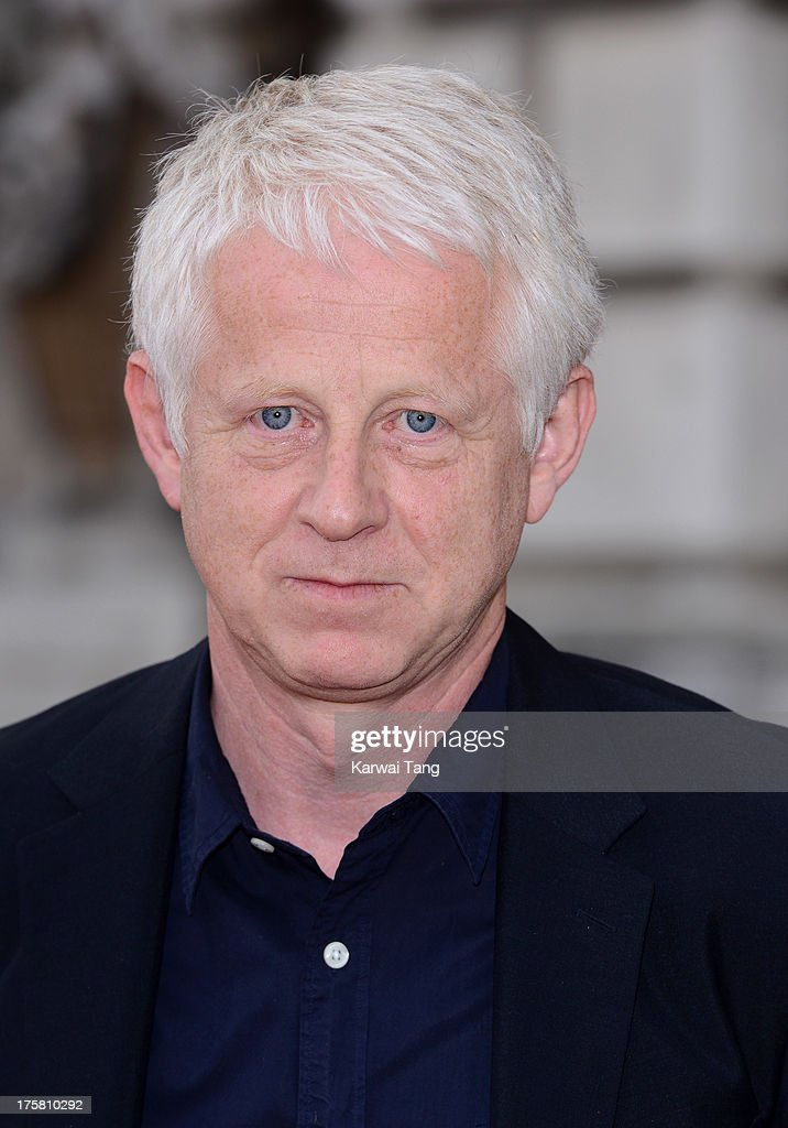 <a gi-track='captionPersonalityLinkClicked' href=/galleries/search?phrase=Richard+Curtis+-+Screenwriter&family=editorial&specificpeople=209106 ng-click='$event.stopPropagation()'>Richard Curtis</a> attends the world premiere of 'About Time' held at Somerset House on August 8, 2013 in London, England.