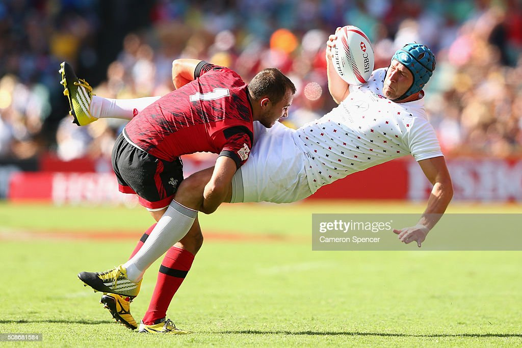 Richard de Carpentier of England is tackled by Luke Treharne of Wales during the 2016 Sydney Sevens match between England and Wales at Allianz Stadium on February 6, 2016 in Sydney, Australia.