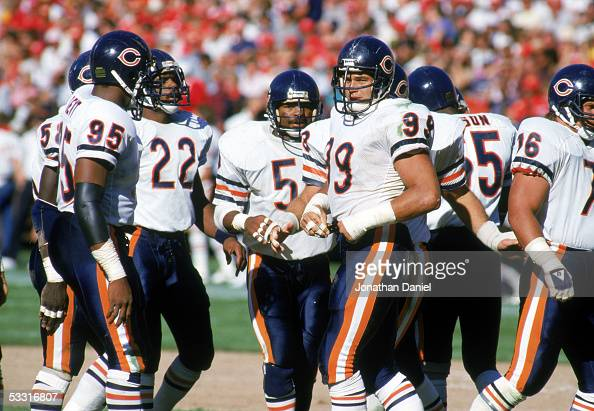 Richard Dent Dave Duerson Mike Singletary and Dan Hampton of the Chicago Bears stand on the field during the game against the San Francisco 49ers at...