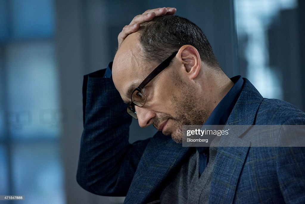 Richard 'Dick' Costolo chief executive officer of Twitter Inc holds his head after a Bloomberg Television interview in San Francisco California US on...