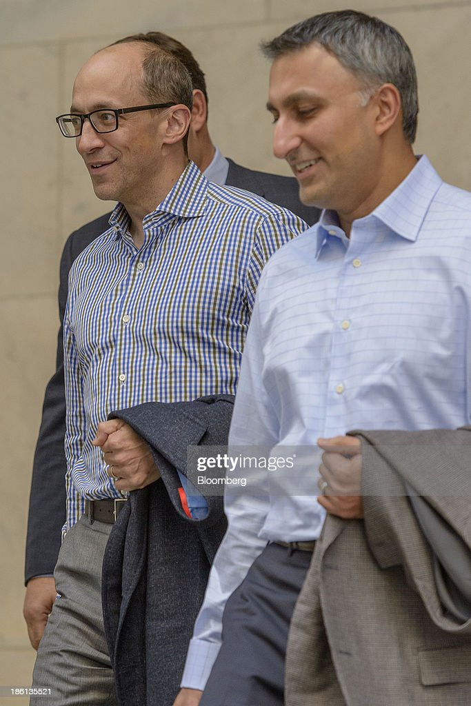 Richard 'Dick' Costolo, chief executive officer of Twitter Inc., left, and Mike Gupta, chief financial officer of Twitter Inc., depart the Ritz-Carlton Hotel in Philadelphia, Pennsylvania, U.S., on Monday, Oct. 28, 2013. The San Francisco-based company is seeking a valuation of 9.5 times 2014 sales in its IPO next month, according to data released in a filing with the Securities and Exchange Commission and analyst projections compiled by Bloomberg. Photographer: Jim Graham/Bloomberg via Getty Images