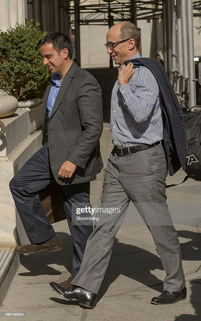 Richard 'Dick' Costolo, chief executive officer of Twitter Inc., right, arrives at the Ritz-Carlton Hotel in Philadelphia, Pennsylvania, U.S., on Monday, Oct. 28, 2013. The San Francisco-based company is seeking a valuation of 9.5 times 2014 sales in its IPO next month, according to data released in a filing with the Securities and Exchange Commission and analyst projections compiled by Bloomberg. Photographer: Jim Graham/Bloomberg via Getty Images
