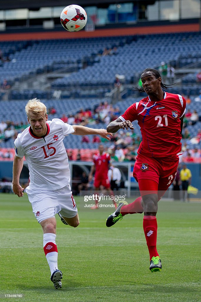 Richard Dixon #21 of Panama clears the ball away with his head from Kyle Bekker #15 of Canada during the first half of a CONCACAF Gold Cup match at Sports Authority Field at Mile High on July 14, 2013 in Denver, Colorado.