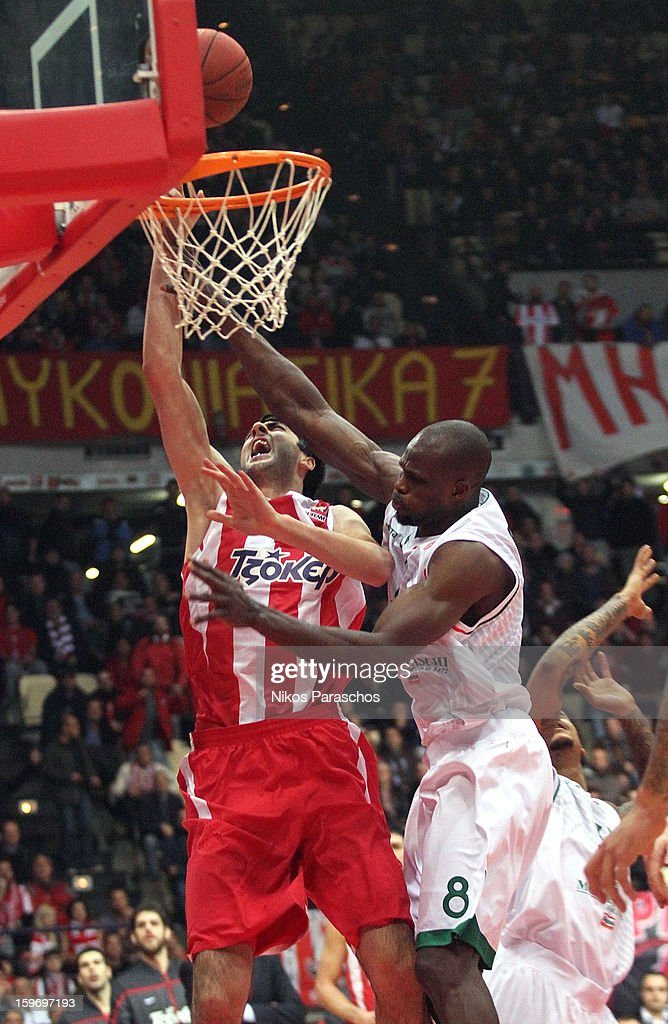 Richard Dorsey, #9 of Olympiacos Piraeus competes with Bejamin Eze, #8 of Montepaschi Siena during the 2012-2013 Turkish Airlines Euroleague Top 16 Date 4 between Olympiacos Piraeus v Montepaschi Siena at Peace and Friendship Stadium on January 18, 2013 in Athens, Greece.