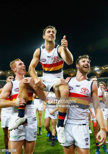 Richard Douglas is chaired off after his 200th game during the round five AFL match between the Gold Coast Suns and the Adelaide Crows at Metricon...