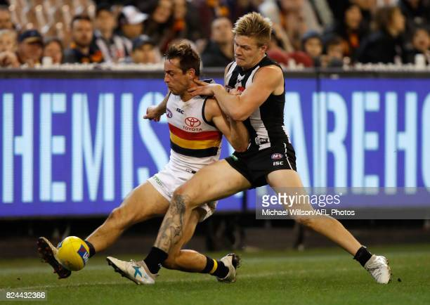 Richard Douglas of the Crows and Jordan De Goey of the Magpies compete for the ball during the 2017 AFL round 19 match between the Collingwood...