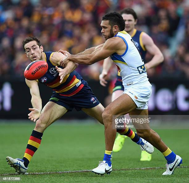 Richard Douglas of the Crows competes for the ball with Harley Bennell of the Suns during the round 17 AFL match between the Adelaide Crows and the...