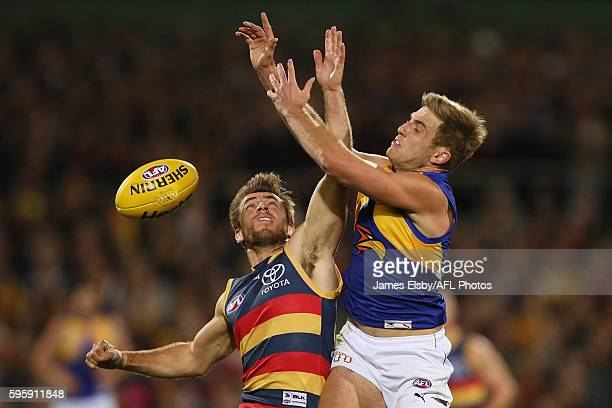 Richard Douglas of the Crows competes with Brad Sheppard of the Eagles during the 2016 AFL Round 23 match between the Adelaide Crows and the West...