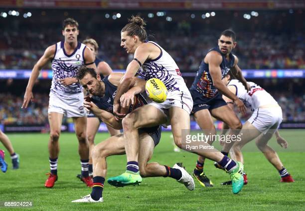 Richard Douglas of the Crows is tackled by Nat Fyfe of the Dockers during the round 10 AFL match between the Adelaide Crows and the Fremantle Dockers...
