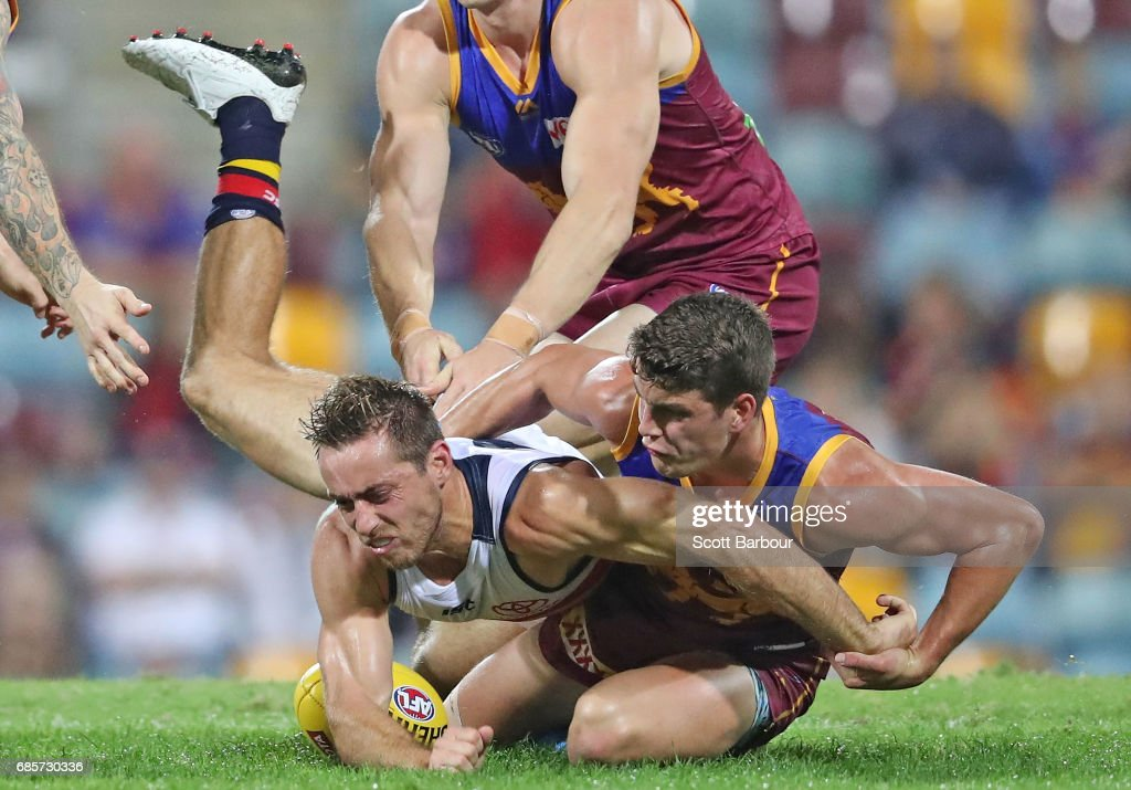 Richard Douglas of the Crows is tackled during the round nine AFL match between the Brisbane Lions and the Adelaide Crows at The Gabba on May 20, 2017 in Brisbane, Australia.