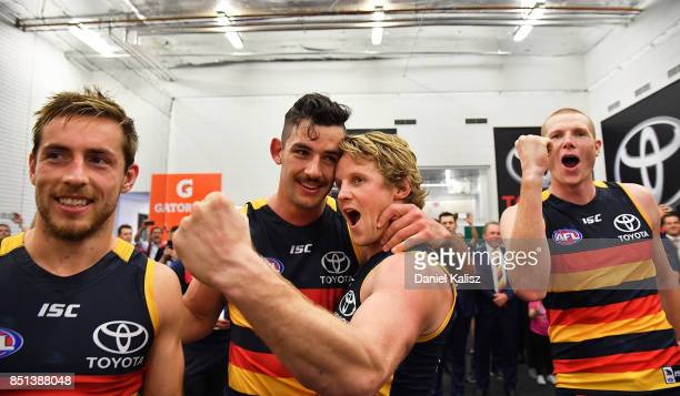 Richard Douglas Taylor Walker Rory Sloane and Sam Jacobs of the Crows celebrate after the First AFL Preliminary Final match between the Adelaide...