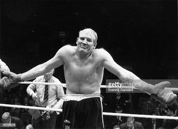 Richard Dunn the boxer is pictured in the boxing ring shrugging his shoulders in wry amusement to the crowd