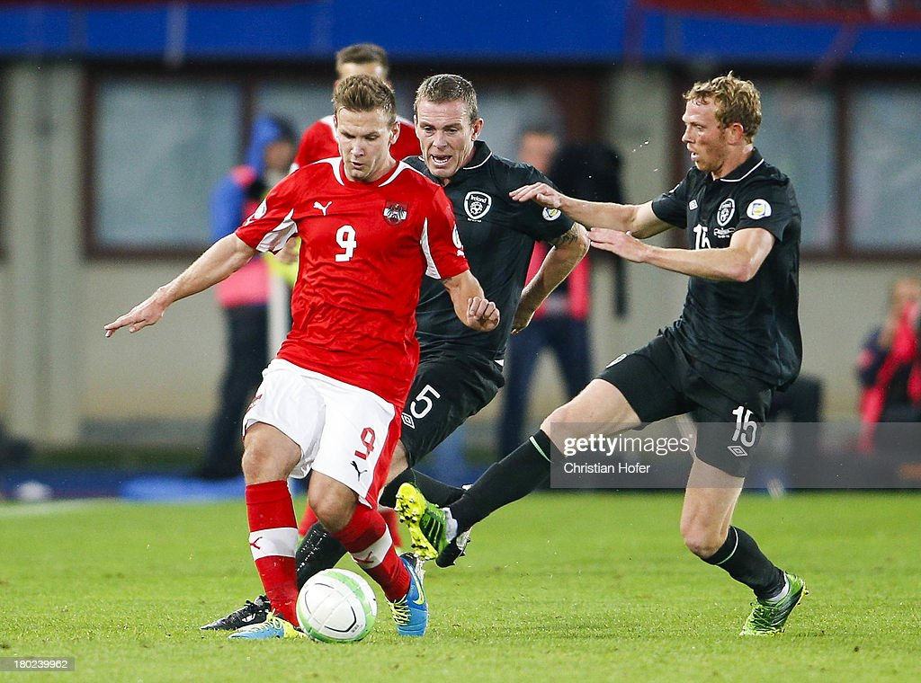 Richard Dunne (C) and Paul Green of Ireland challenge Andreas Weimann of Austria during the FIFA World Cup 2014 Group C qualification match between Austria and the Republic of Ireland at the Ernst Happel Stadium on September 10, 2013 in Vienna, Austria.