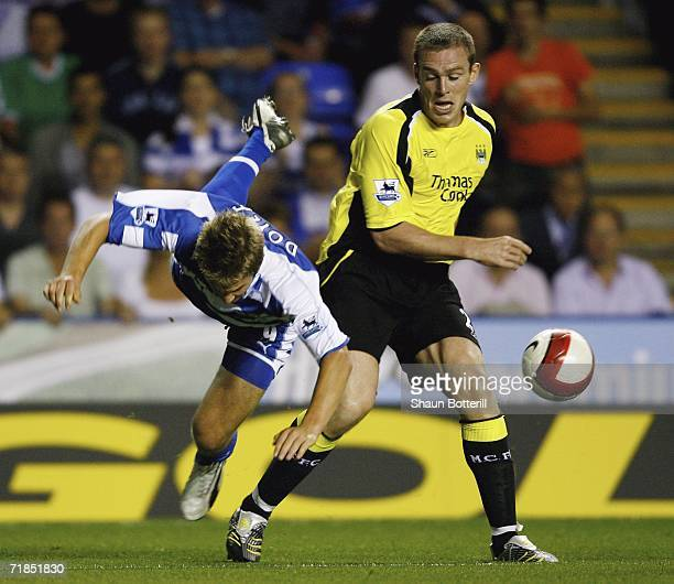 Richard Dunne of Manchester City challenges Kevin Doyle of Reading during the Barclays Premiership match between Reading and Manchester City at the...