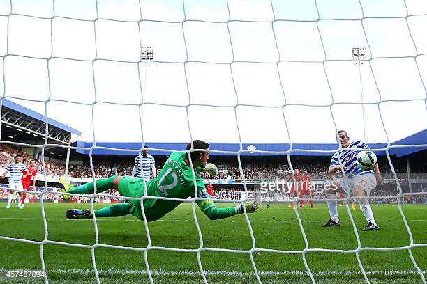 Richard Dunne of QPR scores an own goal past Alex McCarthy during the Barclays Premier League match between Queens Park Rangers and Liverpool at...