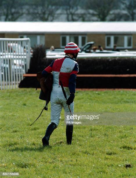 Richard Dunwoody after he fell off Diddy Rymer in the Easter Bonnet Racecourse Claiming Hurdle won by Castle Secret at Newton Abbot * Dunwoody heads...