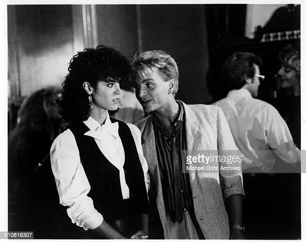 Richard Erdman reassures Betsy Russell in a scene from the movie 'Tomboy' circa 1985