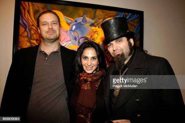 Richard Feigen Robina Seren and Gothic Hangman attend IMMORTAL UNDERGROUND by RON ENGLISH at Opera Gallery on November 12 2009 in New York City