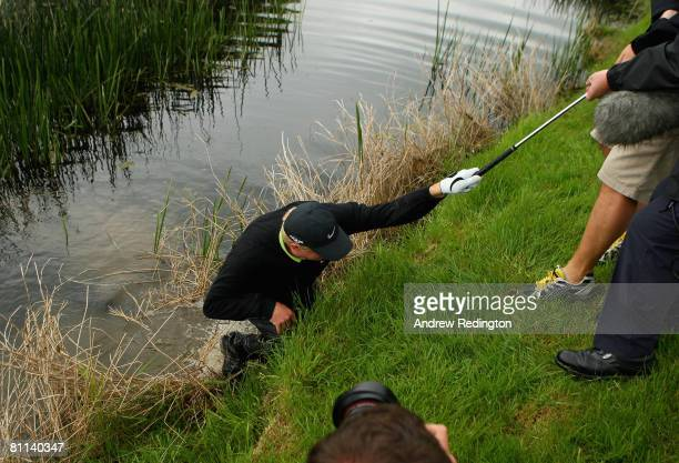 Richard Finch of England is pulled from the river Maigue after falling in it after hitting his third shot on the 18th hole during the final round of...