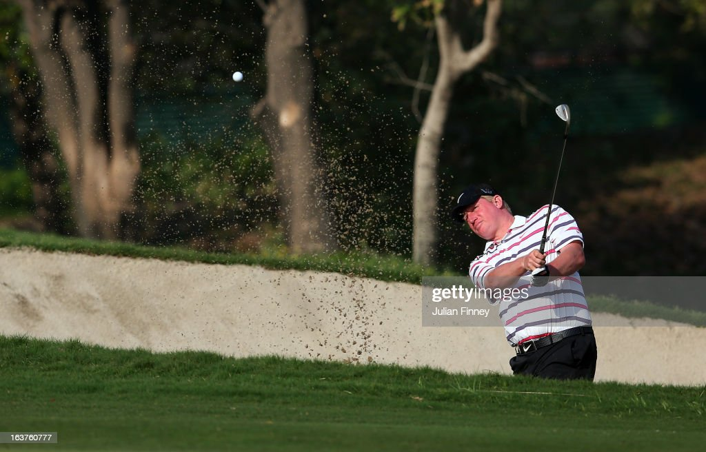 Richard Finch of England plays out of a bunker during day two of the Avantha Masters at Jaypee Greens Golf Club on March 15, 2013 in Delhi, India.