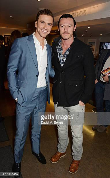 Richard Fleeshman and Luke Evans attend the press night performance of 'Urinetown' at the St James Theatre on March 11 2014 in London England